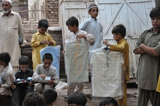 Boys receive their new clothes.