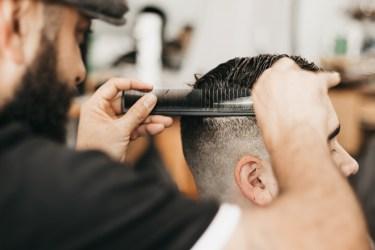 Mr. Antonetti with the comb and scissor.