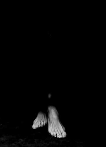 Woman's feet in light & shadow