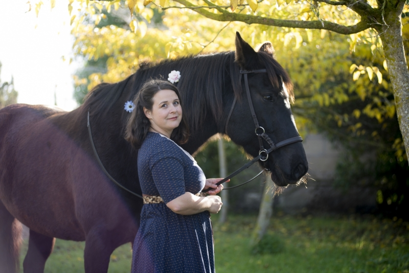 Woman with Black Mare amongst Autumn foliage