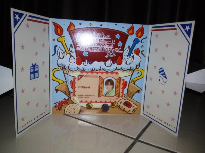 Inside (her name card with a congratulatory message (?))
