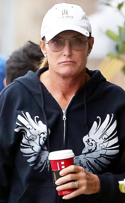 Bruce-Jenner-rocks-ponytail-French-manicure-and-diamond-earrings