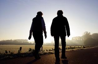 people walking in morning light