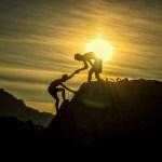 men atop mountain