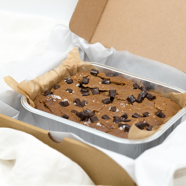 salted almond butter and chocolate chip blondie in a box