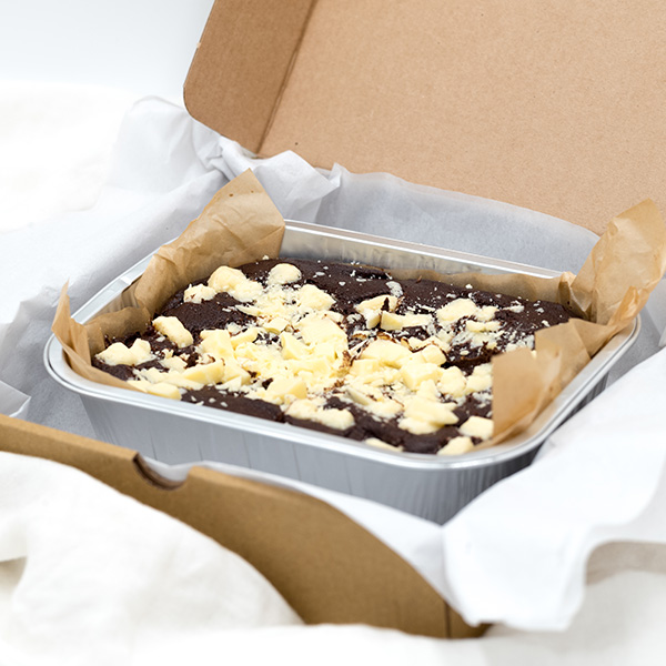 chocolate brownie with white chocolate chip in a box