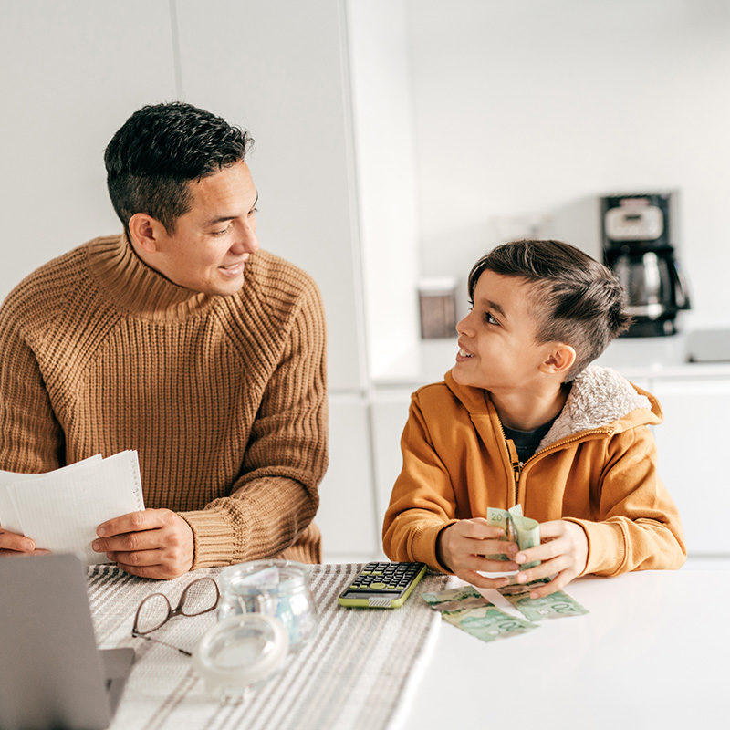 Working-from-home-and-homeschooling-with-elementary-age-child-stock-photo-web.jpg