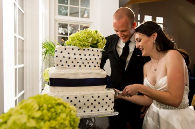 Kevin and Ellery cut their wedding cake during their