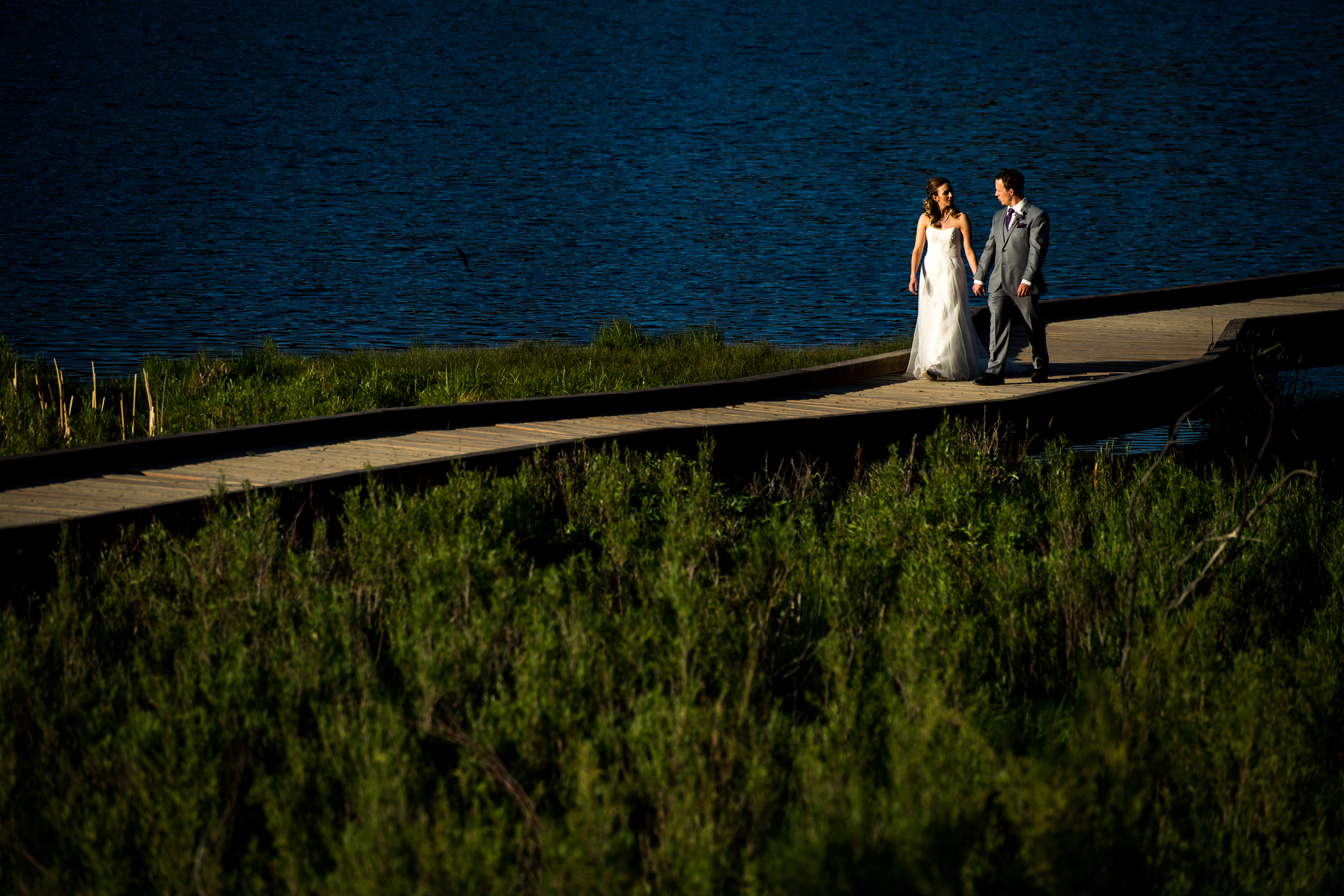 Evergreen Lake House wedding pictures of bride and groom walking