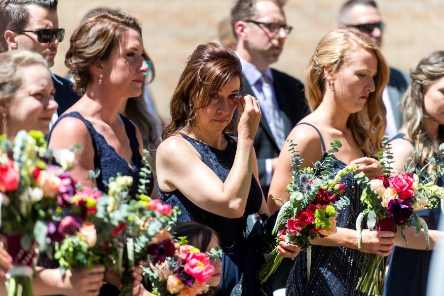 A bridesmaid cries during an Our Lady of Lourdes Denver wedding.