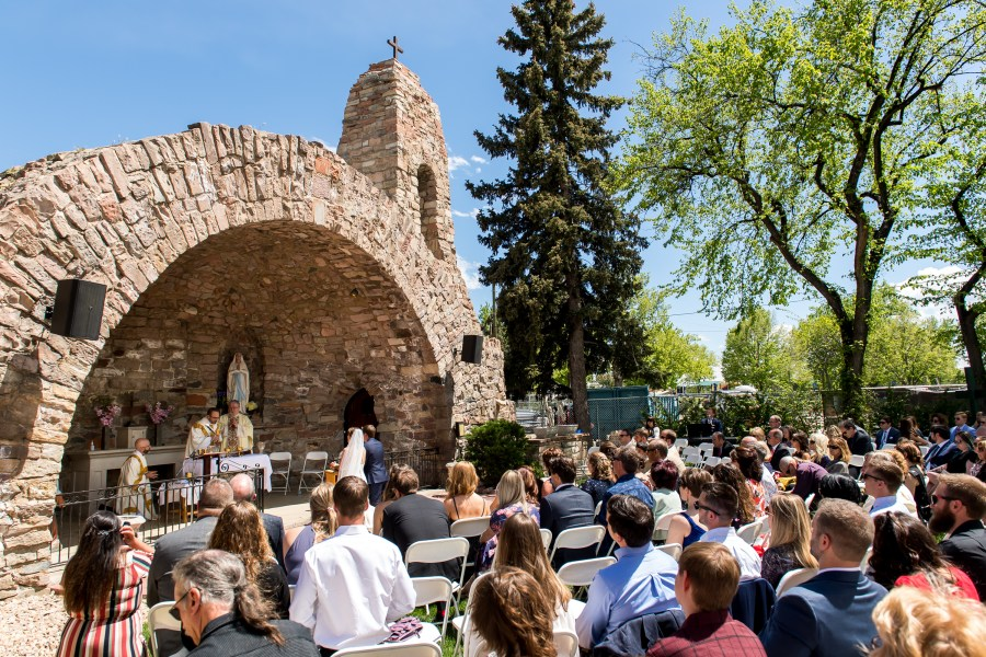 Celebrating Mass during an Our Lady of Lourdes Denver wedding.