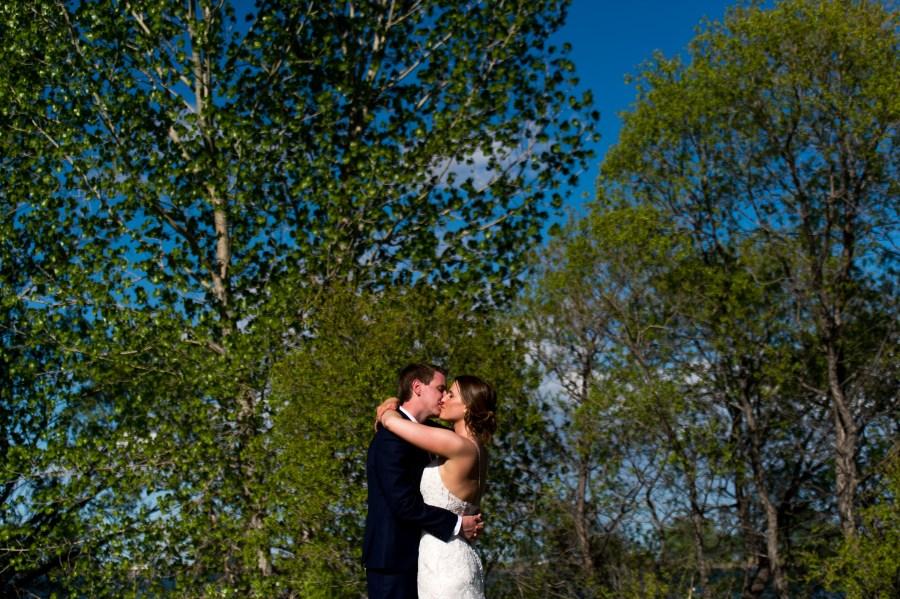 Bride and groom pose during a backyard wedding in Colorado