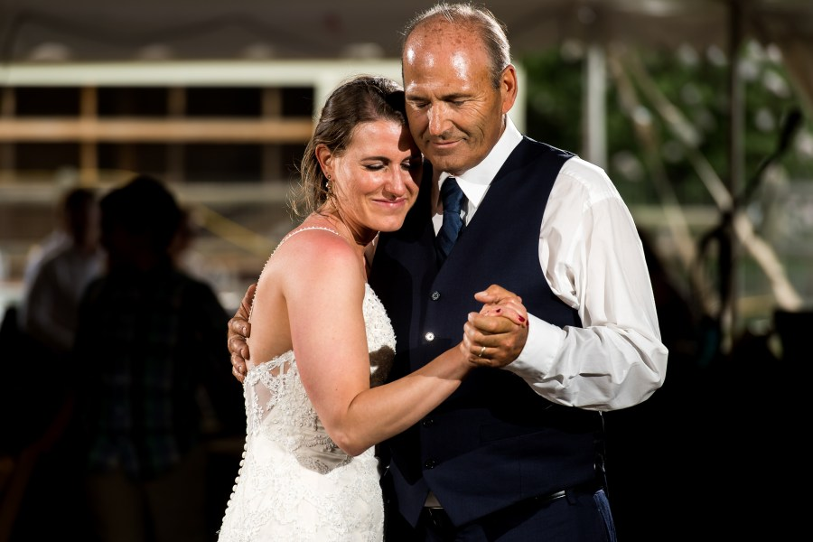 Father-daughter first dance during backyard wedding in Colorado