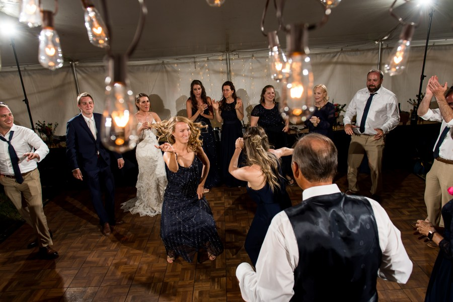 Dancing under the tent during a backyard wedding in Colorado