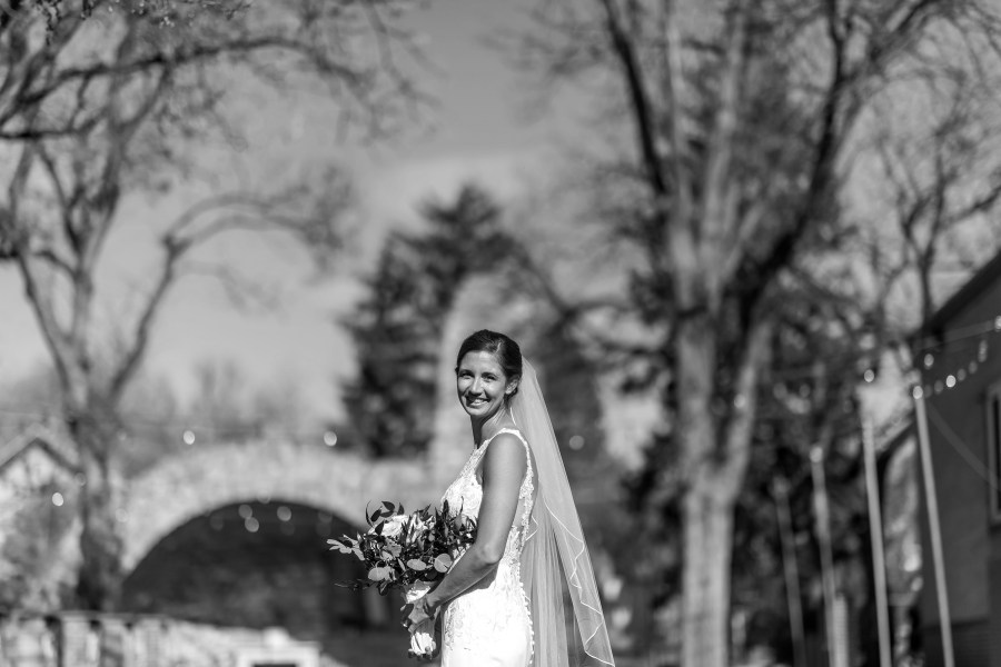 Bride poses after her wedding at Our Lady of Lourdes Catholic Church in Denver, Colorado