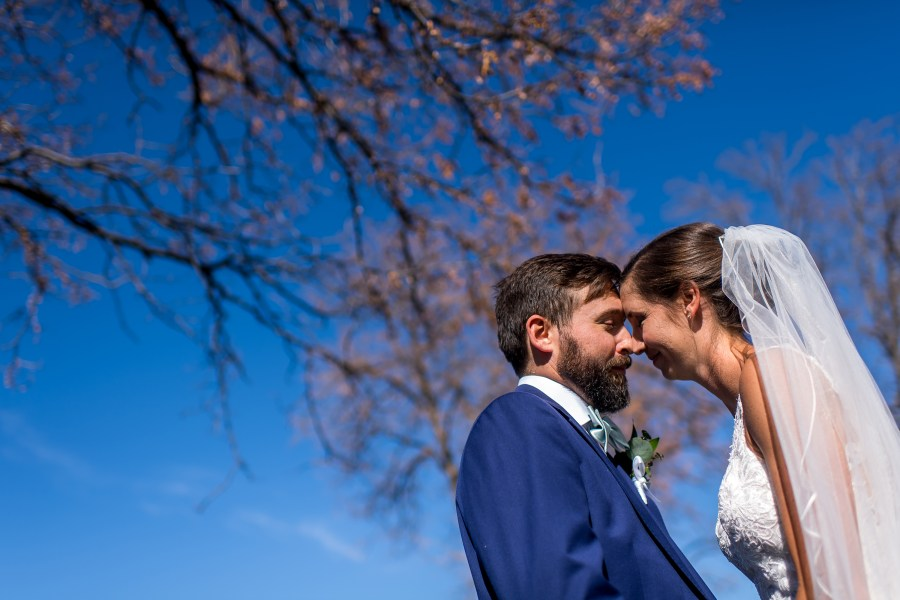 Bride and groom pose after their wedding Mass at Our Lady of Lourdes Catholic Church in Denver, Colorado.