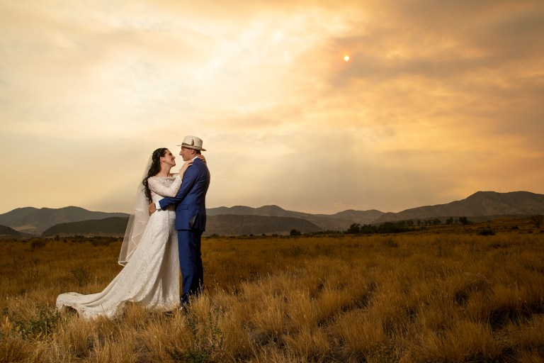 Bride and groom pose during their wedding portrait session at Bear Creek Lake Park in Lakewood, Colorado.