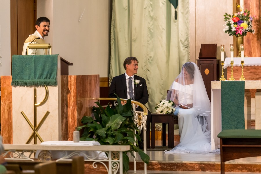 The bride and groom smile during a wedding Mass at St. Joseph Catholic Church in Fort Collins, Colorado, on August 8, 2020.