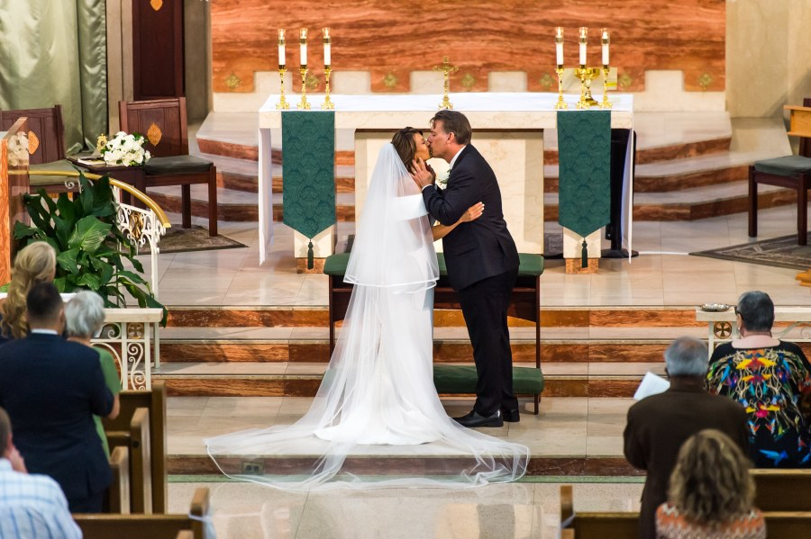 Bride and groom kiss after their St. Joseph Catholic Church wedding on August 8, 2020, in Fort Collins, Colorado.
