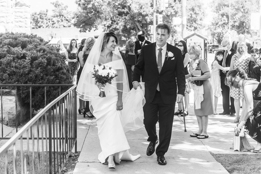 Bride and groom smile during their St. Joseph Catholic Church wedding on August 8, 2020, in Fort Collins, Colorado.