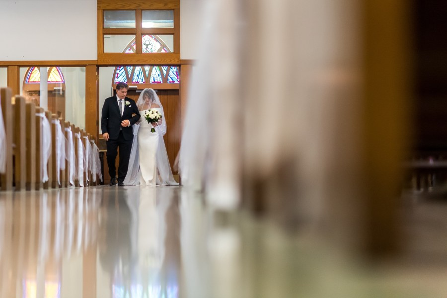 The bride and groom walk down the aisle during a wedding Mass at St. Joseph Catholic Church in Fort Collins, Colorado, on August 8, 2020.