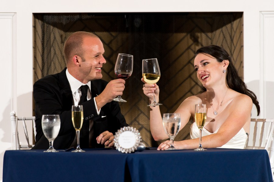 Kevin and Ellery toast each other during their reception