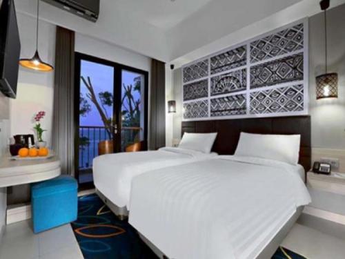 Aston Anyer Beach Club, Hotel View Laut dengan Kelom ...