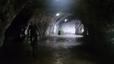 Playing on the bikes in the caves up above La Bastille