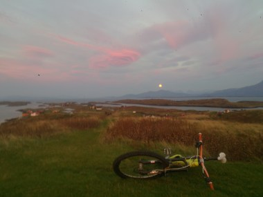 On only the second night on the island I cycled up to the same spot hopeful of another sunset and waited patiently under this unusually shaped cloud whilst the moon rose and the sun went down