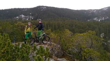 wet and windy enduro mountain biking in bymarka trondheim norway with norrona scott sweet protection