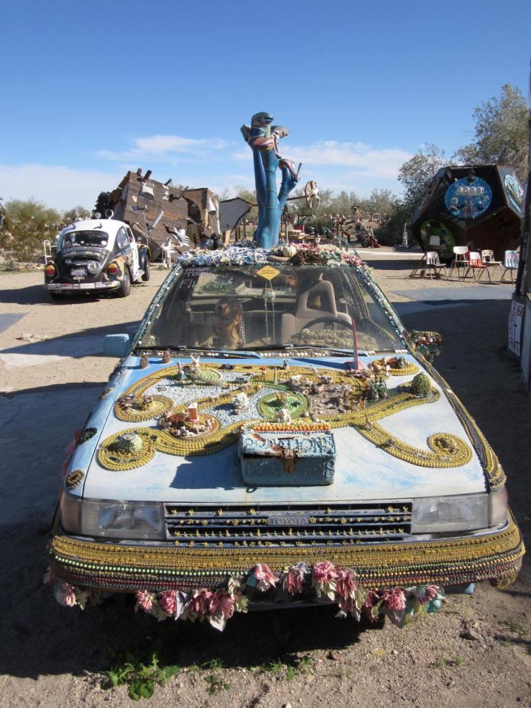 Car at East Jesus Sculpture Park Slab City CA