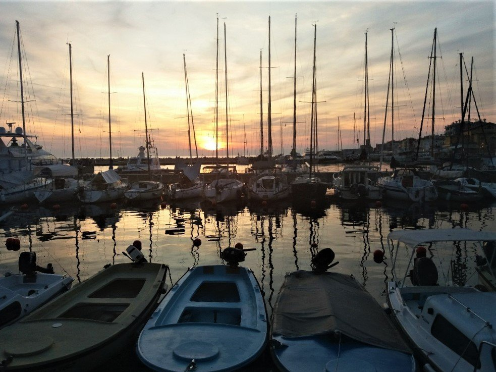 sunset over Piran by the harbour