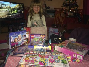 A very lucky girl with a selection of her gifts this year