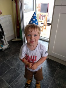 Still happy with his party hat