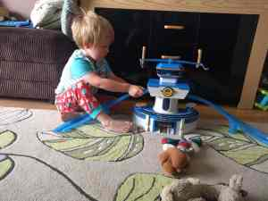 Boy playing with world airport set from super wings