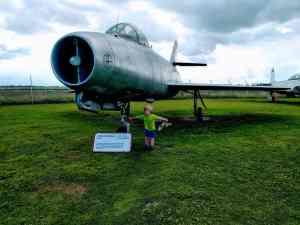 Boy by plane