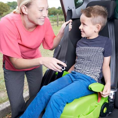 cargoseat with boy being strapped in
