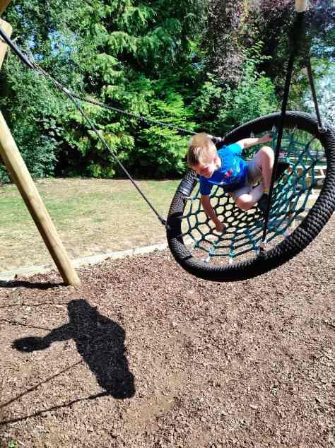 boy on net swing