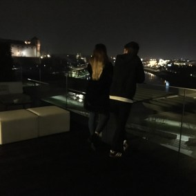 Rooftop bar during the night, Krakow lit up