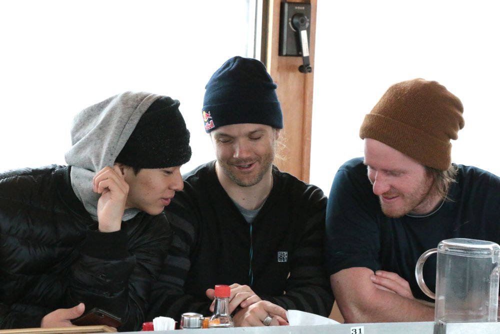 Movement analysis with fellow halfpipe rider, Ayumu Hirano (left), and coach Elijah Teter (right), at the Ramen House located at the base of the halfpipe.