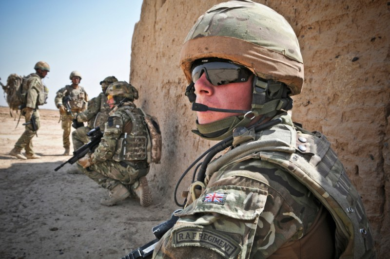 A Gunner of 58 Squadron RAF Regiment conducting a routine patrol near to Camp Bastion in Afghanistan.    The Squadron's role in theatre is to provide force protection to coalition forces operating in the area and patrols such as these help them to engage with the local community.  This was one of the images in the winning submission for Category L 'Photographer of the Year' in the 2012 RAF Photographic Competition.  58 Sqn who are based at RAF Leuchars in Scotland were in Afghanistan April to November 2011.