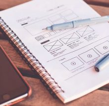 notebook with user interface and wireframe