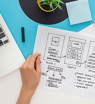 woman holding a website design template