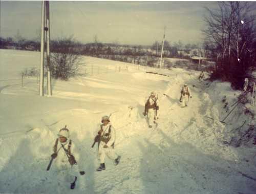 Yanks Trudge through Snow from Humpange,Belgium to St. Vith
