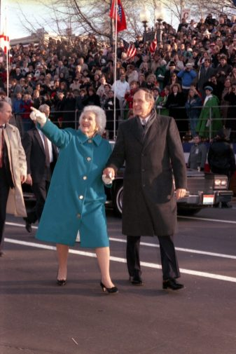 President and Mrs. Bush walk down Pennsylvania Avenue to the White House after the Inauguration at the U.S. Capitol