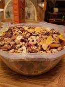 There is a lot of great value trail mix in homemade recipes. I have no idea how many calories are in this trail mix recipe since I bought most of it in bulk. Bulk trail mix nutrition is not my specialty. All I care about is flavor. I made this recipe on the fly. Wanted trail mix bar to munch on, but didn't want to make trail mix bars. So I stopped by the local grocery store. Bought bulk mountain trail mix ingredients, a dried mangos, apricots, cranberries, banana chips, chex cereal & peanut indulgent trail mix to create this camping food. And stored it in an 8 quart tupperware bowl that had a clasping lid. This trail mix recipe lasted 3 weeks.