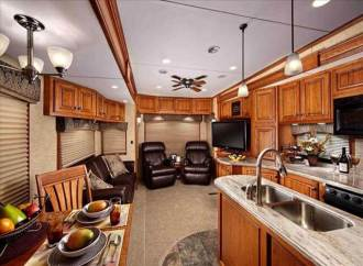 Buying an RV Travel Trailer guide. When Buying an RV guide to interior photos you want to look at the details of the photo. Look at counter tops, and furniture layout. May sure things seem logical before taking ownership. Ask your self what will fit in this fridge, cupboard, or storage area. Ask your self when buying an RV where will I put broom, mop, dog food, clothes, gear? Another thing people forget about when buying an RV is transportation when they get to their destination. Scooters, jeeps, and dune buggies work great for this RV problem. Need more RV buying tips check out my buying an RV guide.