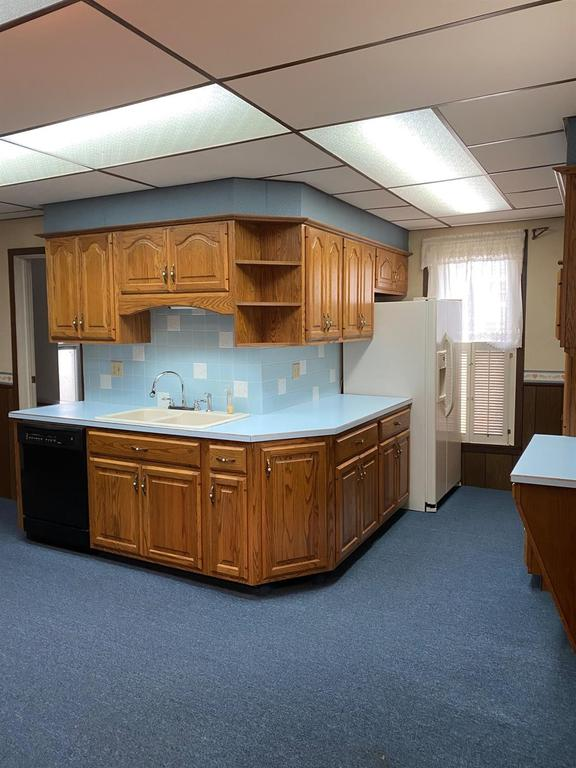 Kitchen featured at 121 E 12th St, Larned, KS 67550