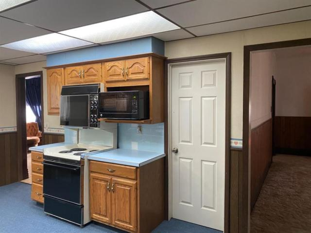 Laundry room featured at 121 E 12th St, Larned, KS 67550