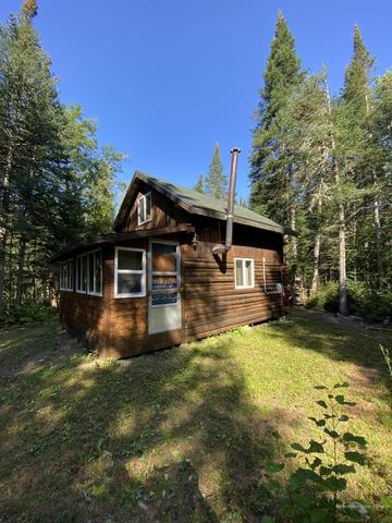 House view featured at 21 Smith Rd, Macwahoc Plt, ME 04451